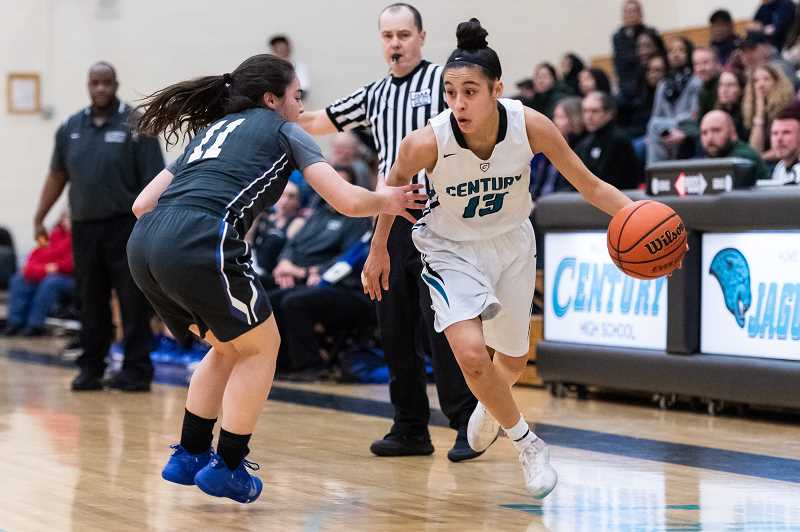 PMG PHOTO: CHRISTOPHER OERTELL - Century's Angie Baltazar dribbles around a St. Mary's defender during the Jaguars' first round playoff game against the Blues Thursday, Feb. 28, at Century High School.