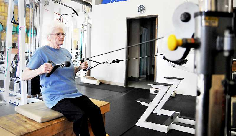 GARY ALLEN - Newberg resident Evelyn Piersall adheres to a strict exercise routine that includes strength training and other activities that, she says, give her energy beyond that of a typical 90 year old.