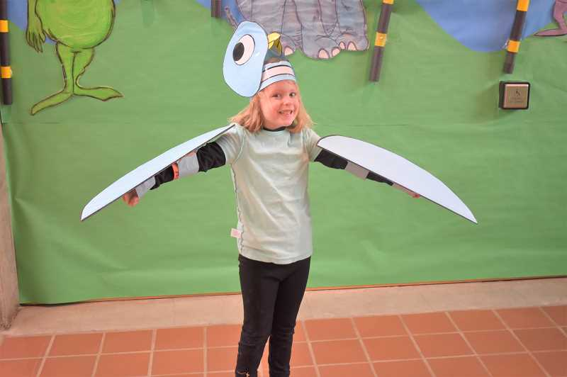 PMG PHOTO: EMILY LINDSTRAND - Maggie Thorston, a kindergartener Clackamas River Elementary School, dressed as Pigeon from Dont Let the Pigeon Drive the Bus! for Read Across America week on Wednesday, Feb. 27.