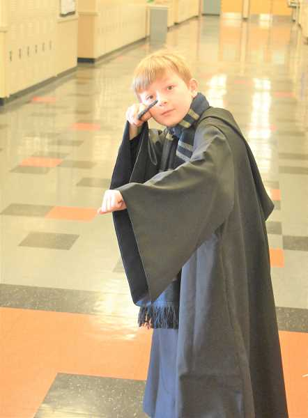 PMG PHOTO: EMILY LINDSTRAND - Estacada Middle School sixth-grader James Cole dressed as Hogwarts teacher Gilderoy Lockhart for Read Across America week.