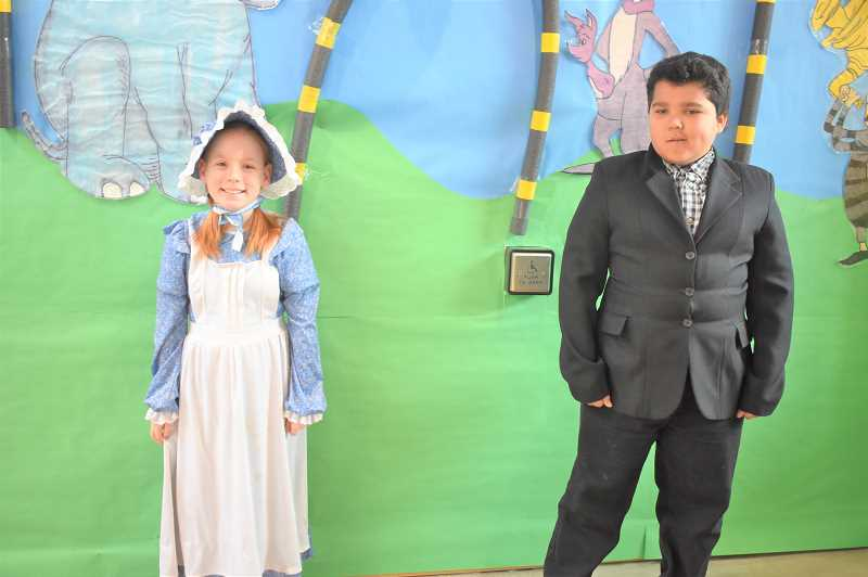 PMG PHOTO: EMILY LINDSTRAND - During Read Across America week, Clackamas River Elementary School fourth graders Madison Gaul and Caleb Palmateer dressed as Laura Ingalls from Little House in the Prairie and George from I Survived.