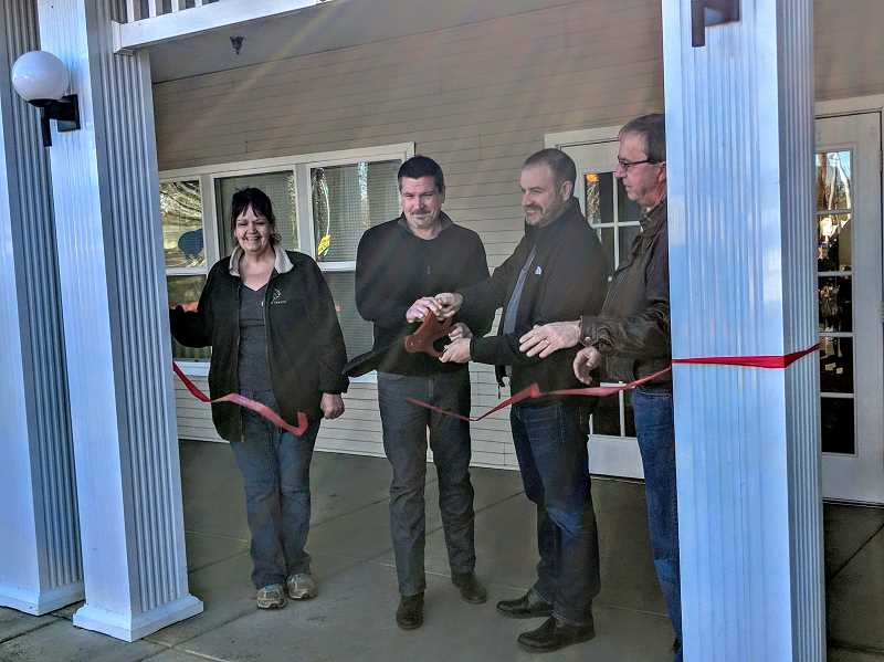 ESTACADA NEWS PHOTO: EMILY LINDSTRAND - Leaders from the Adult and Teen Challenge Estacada location and the Estacada Chamber of Commerce are triumphant after a ribbon cutting on Saturday, March 2.