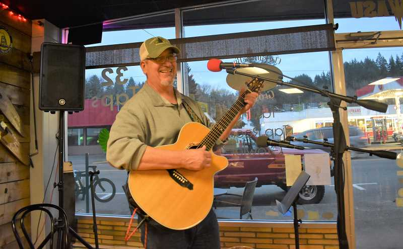 ESTACADA NEWS PHOTO: EMILY LINDSTRAND - Rick Darling hosts an open mic night at Clackamas River Growlers on Thursdays.