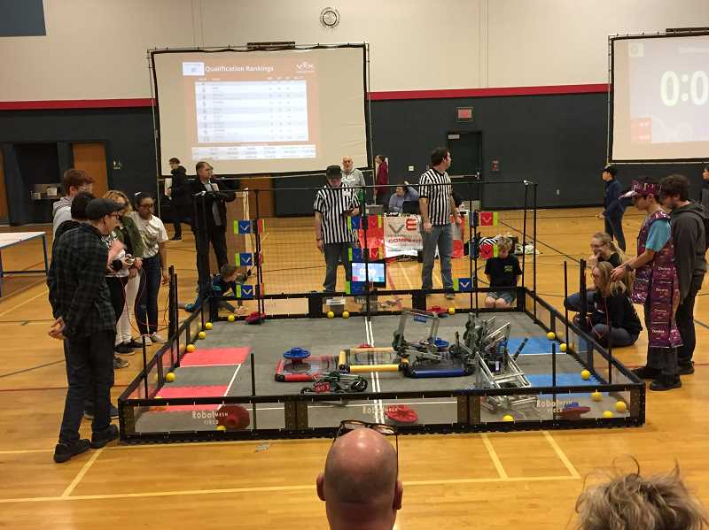 COURTESY PHOTO - Team Thanos members compete with their robot at the last competition leading up to state.