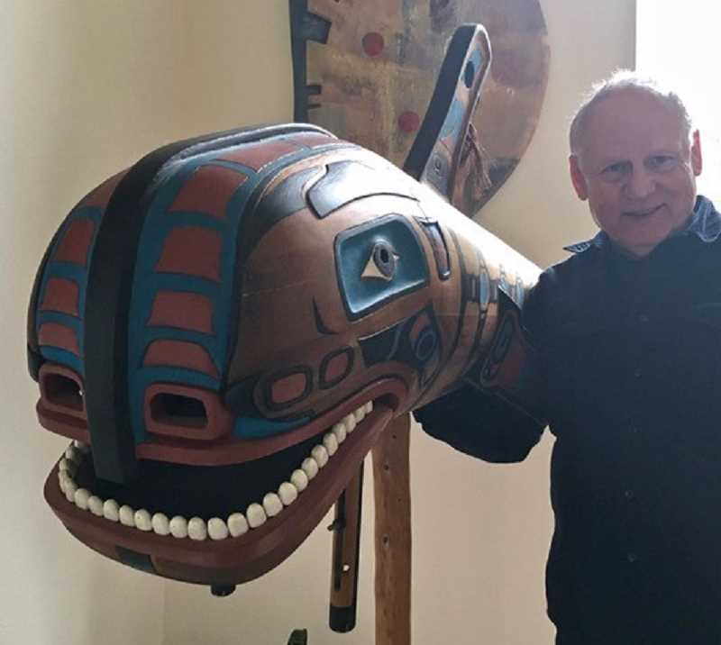Ray Losey demonstrated how one of his masks, a five-foot-long stylized whale complete with fins, has a hinged jaw to serve as a drum.