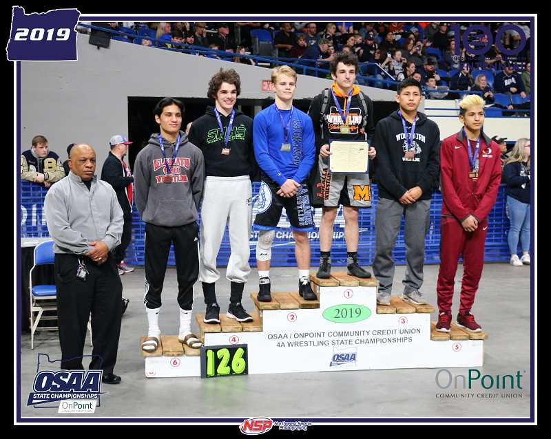 SUBMITTED PHOTO - Max Tate stands atop the podium after winning Molalla a state champion.