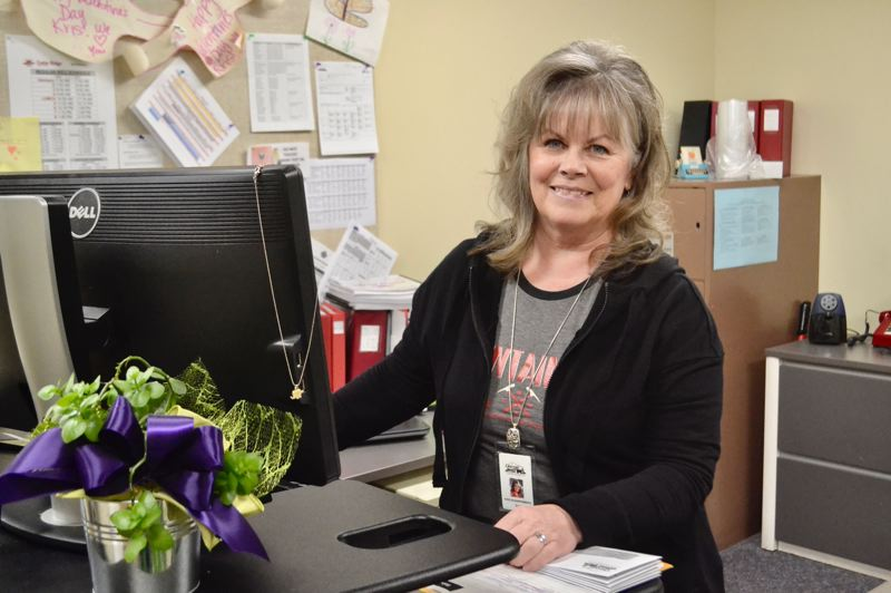 POST PHOTO: BRITTANY ALLEN - Kris Scharfenberg has been the principal's secretary at Cedar Ridge Middle School for almost 32 years.