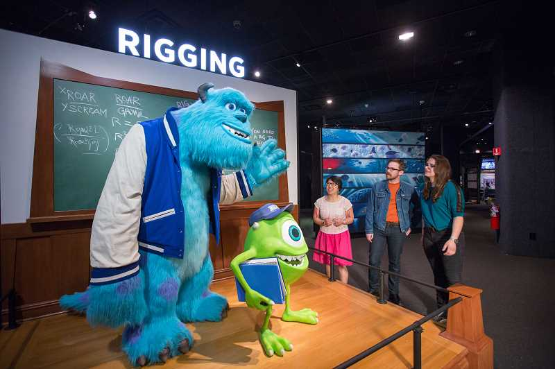 In the rigging area, visitors pose with models of Mike and Sulley from Monsters University. It is part of the Science Behind Pixar on exhibit at OMSI now through Sept. 2.