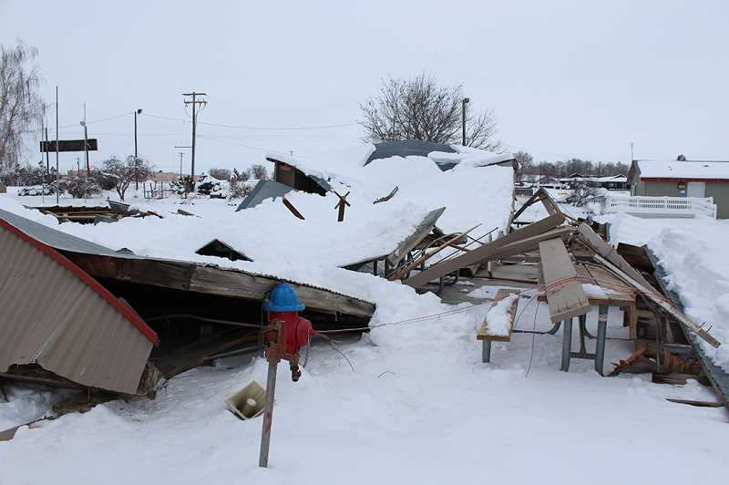 HOLLY M. GILL/MADRAS PIONEER - The roof of the Lamonte Horney Picnic Pavilion collapsed under the weight of last week's snow. The pavilion was insured, but the county hasn't yet determined its next step to replace the facility.