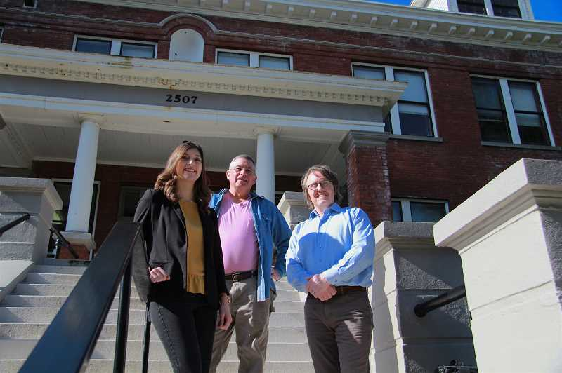 PMG PHOTO: SAM STITES - From left: Sierra Parsons, Mark Browne and Andrew Grover pose on the front steps of the former Christie School, now headquarters of Youth Villages Oregon, where they continue to serve a similar demographic of children as the school once did.