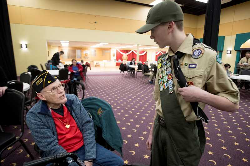 PMG PHOTO: JAIME VALDEZ - Frank Walsh, 95, representing American Legion Post 65, meets with Boy Scout Troop 528 member Ansen Lackner, 13, during an event at the Al Kader Shrine Center.