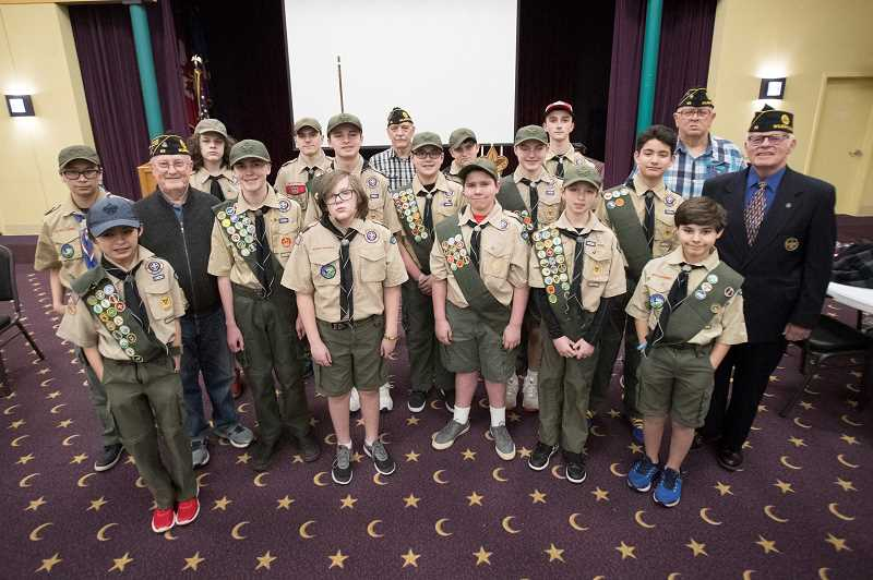PMG PHOTO: JAIME VALDEZ - American Legion Post 65 members and Boy Scouts from Troop 528 pose for a picture at an event at the Al Kader Shrine Center.