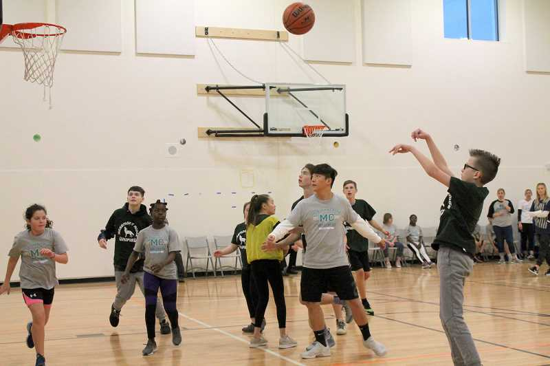 PMG PHOTO: HOLLY BARTHOLOMEW - The Unified Sports basketball teams from Rosemont Ridge and Meridian Creek matched up at a tournament Feb. 26.