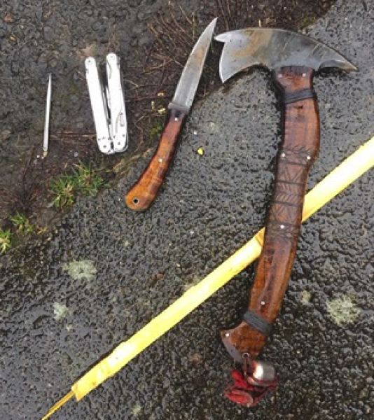 PORTLAND POLICE BUREAU - Police arrested a man armed with a hatchet, a knife and a multi-tool near a middle school in Southeast Portland on March 6.