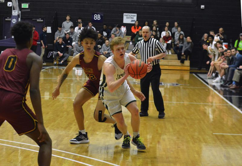 TIMES PHOTO: MATT SINGLEDECKER - Jesuit senior Aiden Williams had 13 points and six rebounds against Central Catholic in the 6A quarters.