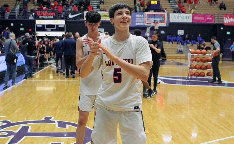 PMG PHOTO: MILES VANCE - Lake Oswego junior Casey Graver claps as he walks off the court at the end of his team's 69-30 win over Oregon City in the quarterfinals of the Class 6A state tournament at the Chiles Center on Wednesday.