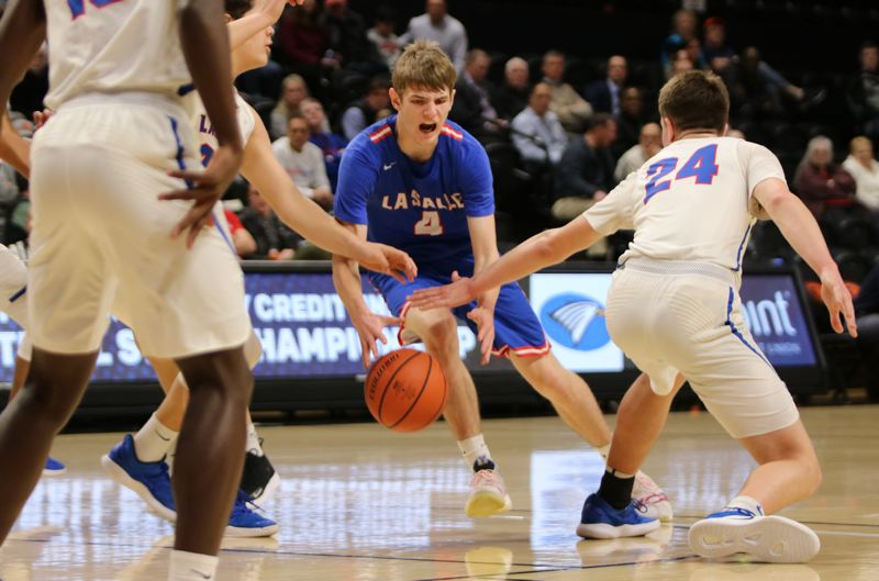 PMG PHOTO: JIM BESEDA - La Salle Prep's Jace Norton (4) ran into significant defensive resistance in the Falcons' 82-55 loss to Churchill in Wednesday's OSAA Class 5A boys' basketball quarterfinals at Gill Coliseum.