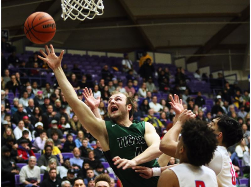 PMG PHOTO: DAN BROOD - Tigard High School senior Stevie Schlabach puts up a shot during the first quarter of the Tigers' state tournament quarterfinal game with South Salem on Wednesday.