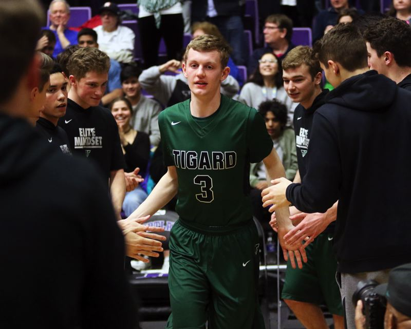 PMG PHOTO: DAN BROOD - Tigard High School senior Jake Bullard takes the court during pregame introductions Wednesday at the Chiles Center.