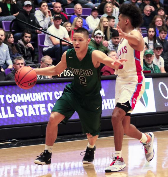 PMG PHOTO: DAN BROOD - Tigard senior Jazz Ross (left) looks to get past South Salem senior Jaden Nielsen-Skinner during Friday's state tournament game.