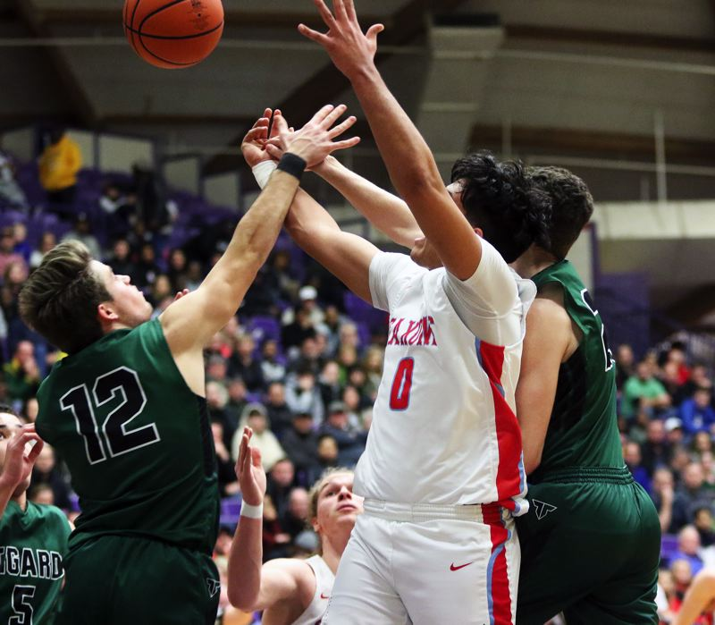 PMG PHOTO: DAN BROOD - Tigard High School seniors Carson Crist (left) and Luke Ness battle South Salem senior Treyden Harris for a rebound during Wednesday's state tournament game.