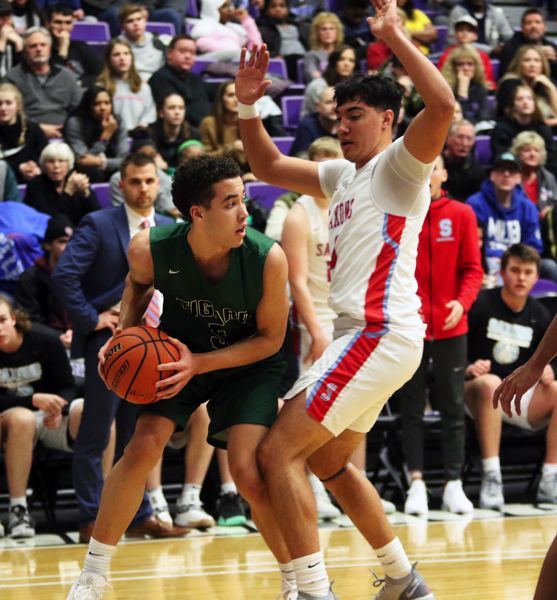 PMG PHOTO: DAN BROOD - Tigard sophomore Drew Carter (left) looks to pass the ball past South Salem senior Treyden Harris during Wednesday's Class 6A state tournament game.