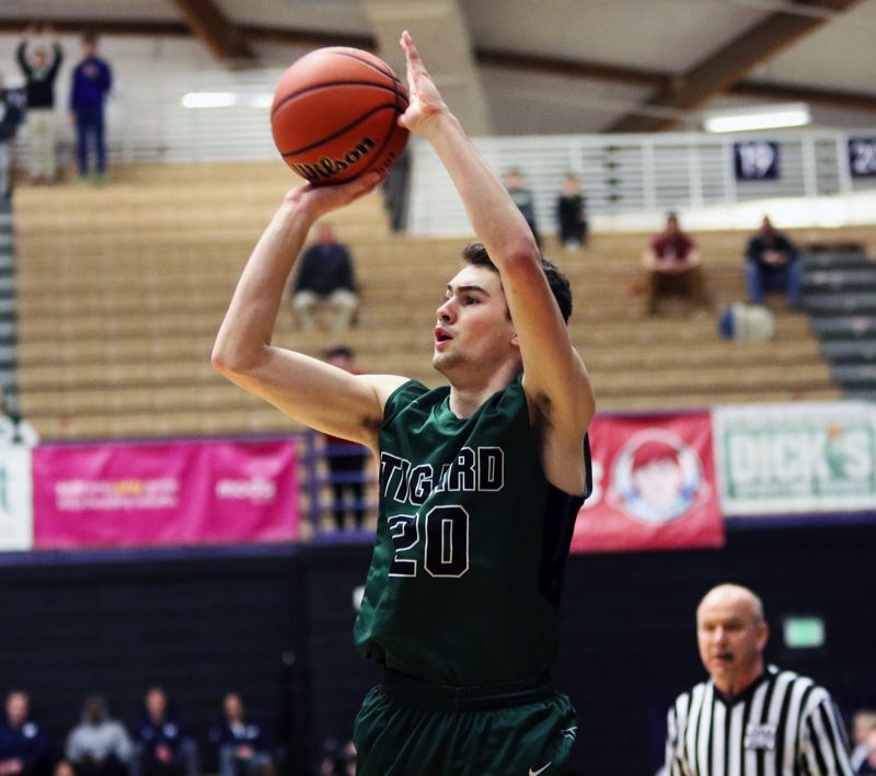PMG PHOTO: DAN BROOD - Tigard senior Luke Ness goes up for a jump shot during Wednesday's state tournament game at the Chiles Center.