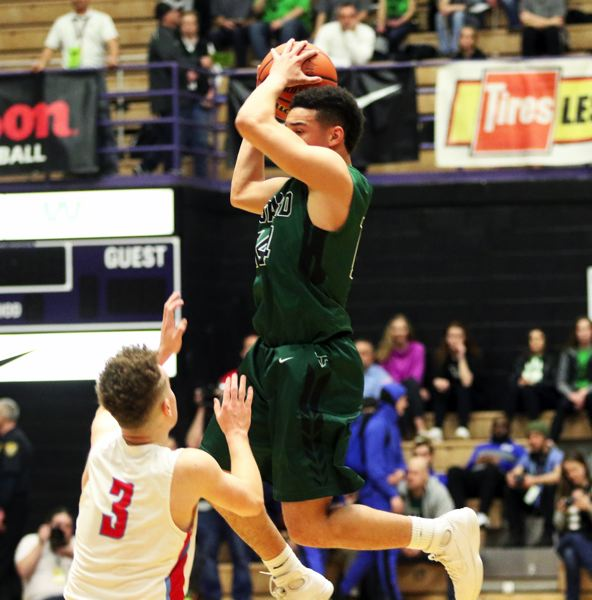 PMG PHOTO: DAN BROOD - Tigard High School junior Max Lenzy (right) goes up high above South Salem junior Trey Galbraith to grab a pass during Wednesday's state tournament game.
