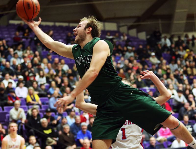 PMG PHOTO: DAN BROOD - Tigard High School senior Stevie Schlabach goes to the basket during the Tigers' state tournament game with South Salem on Wednesday.