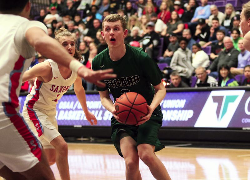 PMG PHOTO: DAN BROOD - Tigard senior Jake Bullard looks to get to the basket during Wedneday's game at the Class 6A state tournament.
