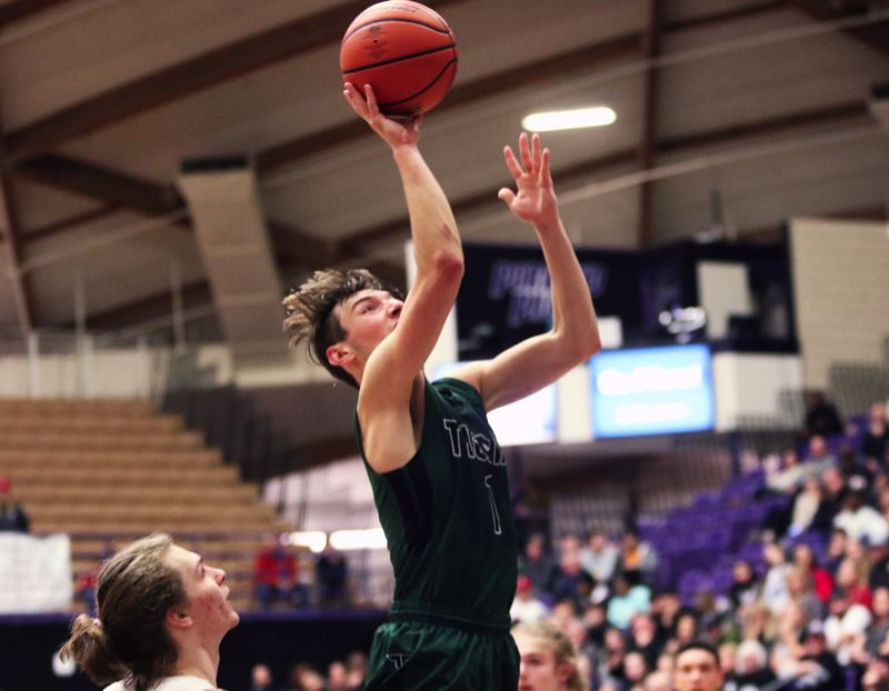 PMG PHOTO: DAN BROOD - Tigard High School senior Diego Lopez goes up high to put up a shot during the Tigers' game with South Salem Wednesday at the Class 6A state tournament.