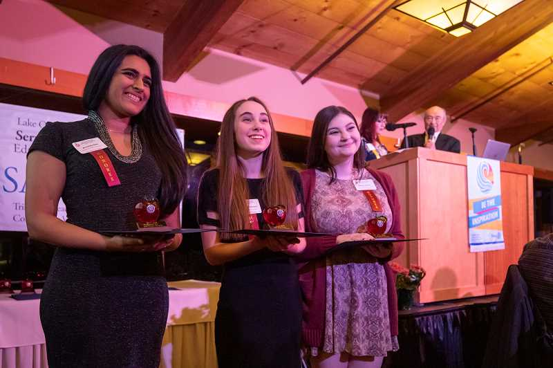 PMG PHOTO: JONATHAN HOUSE - From left, Anushka Nair, Pauline Petersen and Margo Sidline won the Student Awards during the Lake Oswego Rotary Club SASEE Awards Banquet.