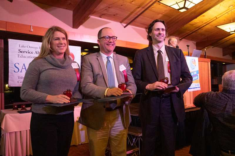 PMG PHOTO: JONATHAN HOUSE - From left, Aletia Cochran, Andrew Duden and Ben Kinkley won the Educator Award during the Lake Oswego Rotary Club SASEE Awards Banquet.