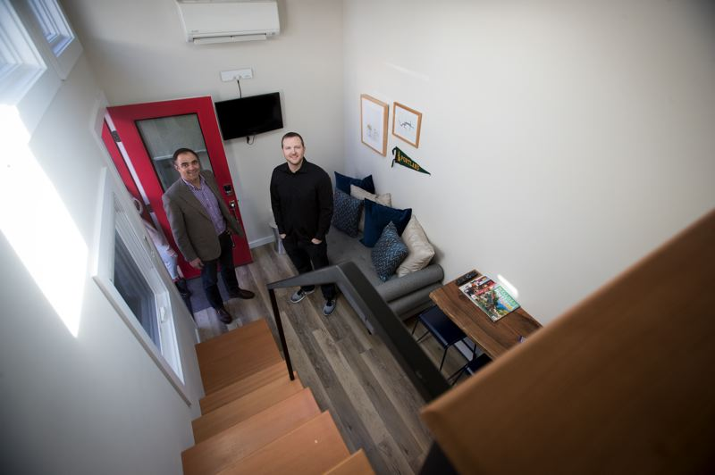 PMG PHOTO: JAIME VALDEZ - Slabtown Village owners Grant Norling, left, and John Jendritza stand in one of three eight-foot-wide tiny houses that, along with three small Victorian houses, make up the unique hotel in Northwest Portland.