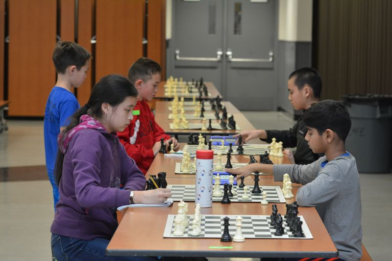 PMG PHOTO: COURTNEY VAUGHN - Pahlychai Thao competes against Narasa Tummuru during the Mike Sheehan Memorial Chess Tournament in Scappoose.