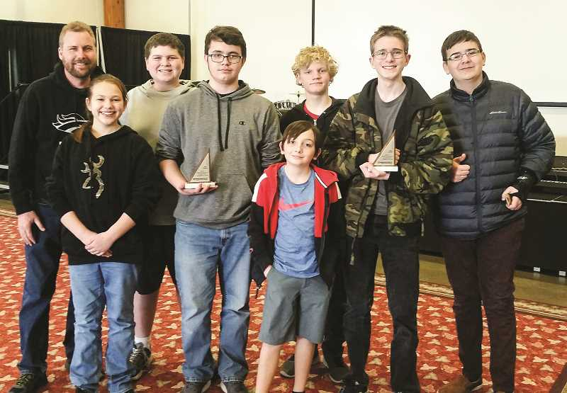 PHOTO COURTESY OF MATT FISCHER  - The Crook County Middle School team placed third in the Feb. 23 Central Oregon Chapter Math Counts Competition. Pictured left to right, Matt Fischer, Aspen Gunderson, Stephen Strong, Zane Webster, River Nortz (front), Ashton Jarrell, Jacob Mead and Aiden Teague.