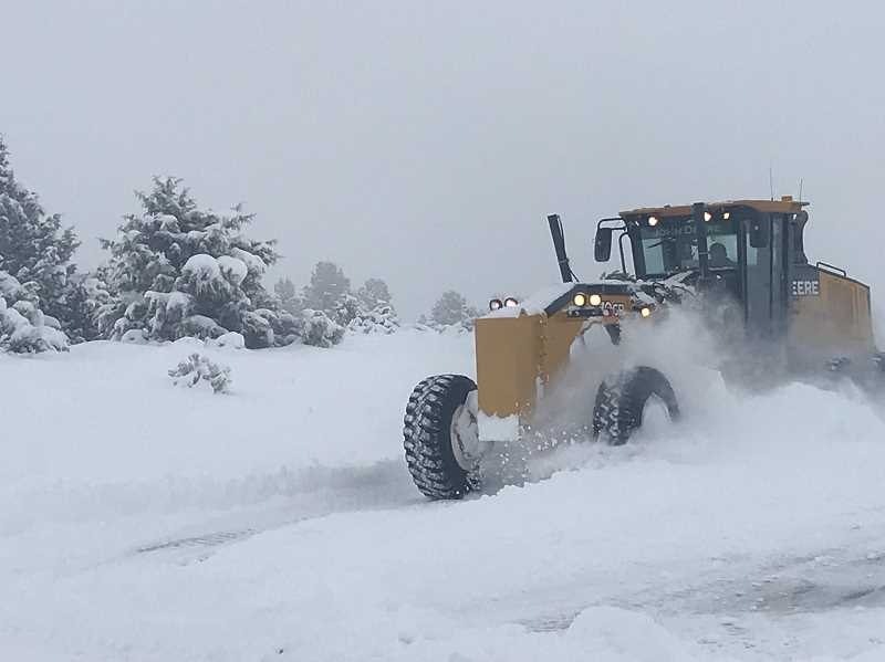 PHOTO COURTESY OF CITY OF PRINEVILLE - Road crews throw as many hours and pieces of equipment at plowing efforts as possible.
