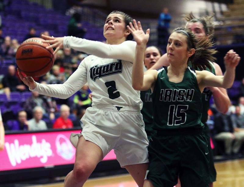 PMG PHOTO: DAN BROOD - Tigard junior guard Kennedy Brown (left) goes to the basket against Sheldon sophomore Olivia Pierzina during Thursday's Class 6A state tournament game.