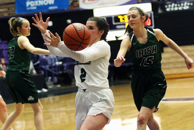 PMG PHOTO: DAN BROOD - Tigard High School junior Kennedy Brown tries to get the handle on a loose ball during Thursday's Class 6A state tournament game with Sheldon.