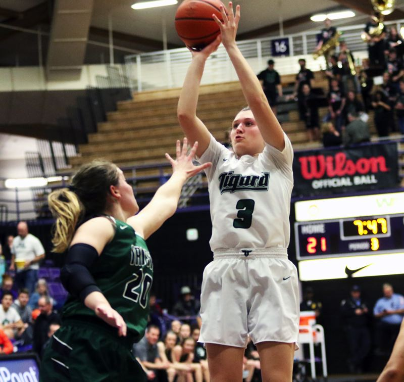 PMG PHOTO: DAN BROOD - Tigard High School senior Campbell Gray (right) shoots a jumper over Sheldon senior Kami Walk during Thursday's Class 6A state tournament game.