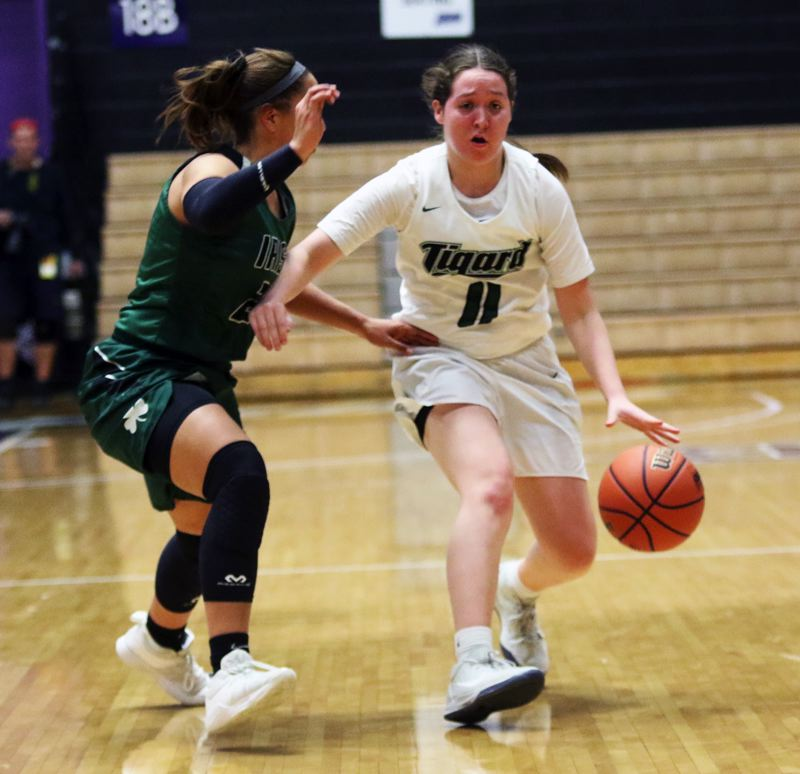 PMG PHOTO: DAN BROOD - Tigard High School senior guard Paige LaFountain brings the ball up court during the Tigers' state tournament game with Sheldon.