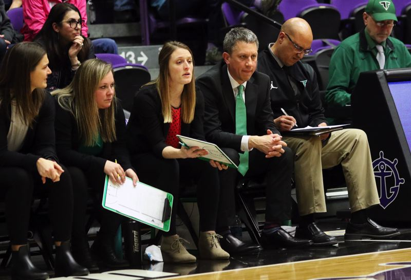 PMG PHOTO: DAN BROOD - Tigard coaches (from left) Heidi DeHaan, Erica Hansen, Mallory Goldammer, Steve Naylor and Jason Ashley watch the action during Thursday's state tournament playoff game.