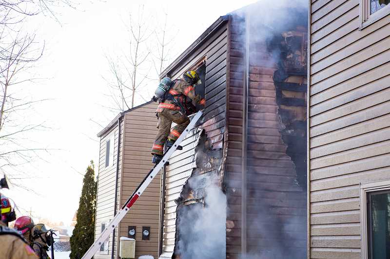 COURTESY PHOTO: GREG MUHR, GRESHAM FIRE - Gresham firefighters can go from drinking a cup of coffee to pulling a child out of a burning building in the blink of an eye.