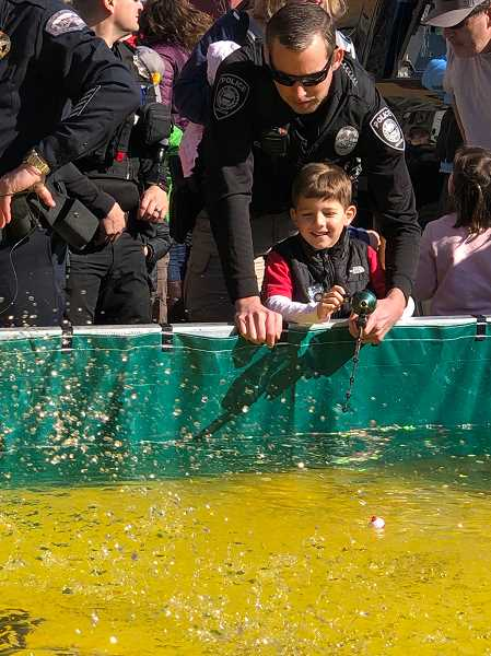 COURTESY PHOTO: GRESHAM POLICE DEPARTMENT - Gresham Police officers had fun fishing with kids over the weekend.