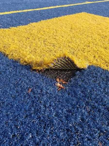 COURTESY PHOTO: CSD - Canby's current synthetic turf is ripping at the seams.