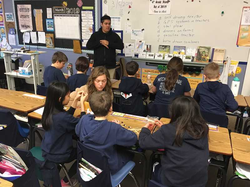 COURTESY OF OREGON AGRICULTURE IN THE CLASSROOM FOUNDATION - Caitlin Blood, MITCH agriculture teacher, elicits student ideas as they construct their load bearing devices.