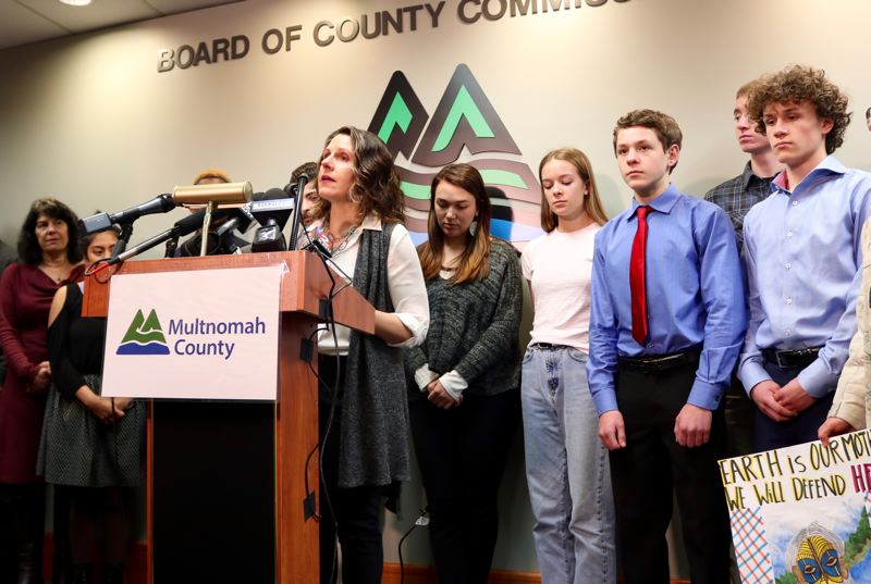 PMG PHOTO: ZANE SPARLING - Multnomah County chair Deborah Kafoury announces the county's legal action on Friday, March 8 while flanked by student plaintiffs in the Oregon climate kids lawsuit.