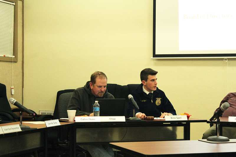 KRISTEN WOHLERS - Brice Sperl, right, leads the February board meeting.