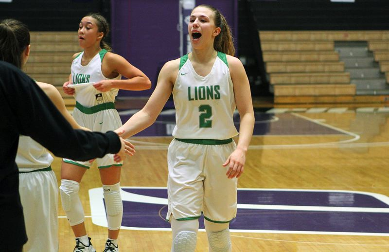 PMG PHOTO: MILES VANCE - West Linn sophomore guard Cami Fulcher lets out a yell after her team beat South Medford 65-56 in overtime in the consolation semifinals at the Class 6A state tournament at the Chiles Center on Friday.
