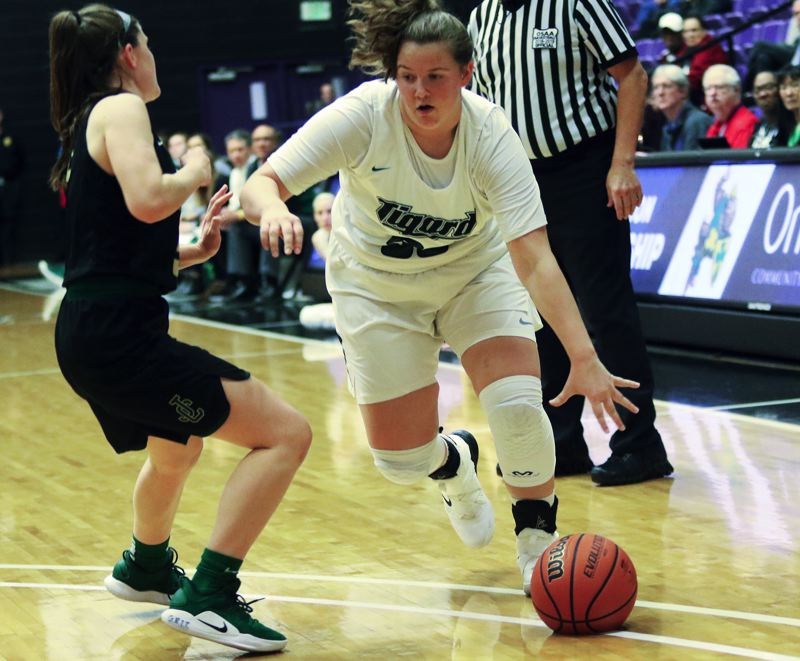 PMG PHOTO: DAN BROOD - Tigard senior post Dani Lyons (right) looks for room to drive during the Tigers' state tournament win over Jesuit.